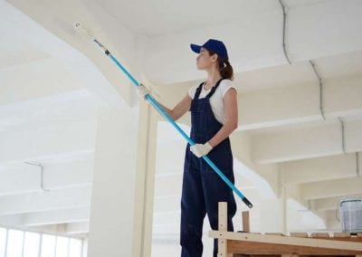 Woman painting house interior
