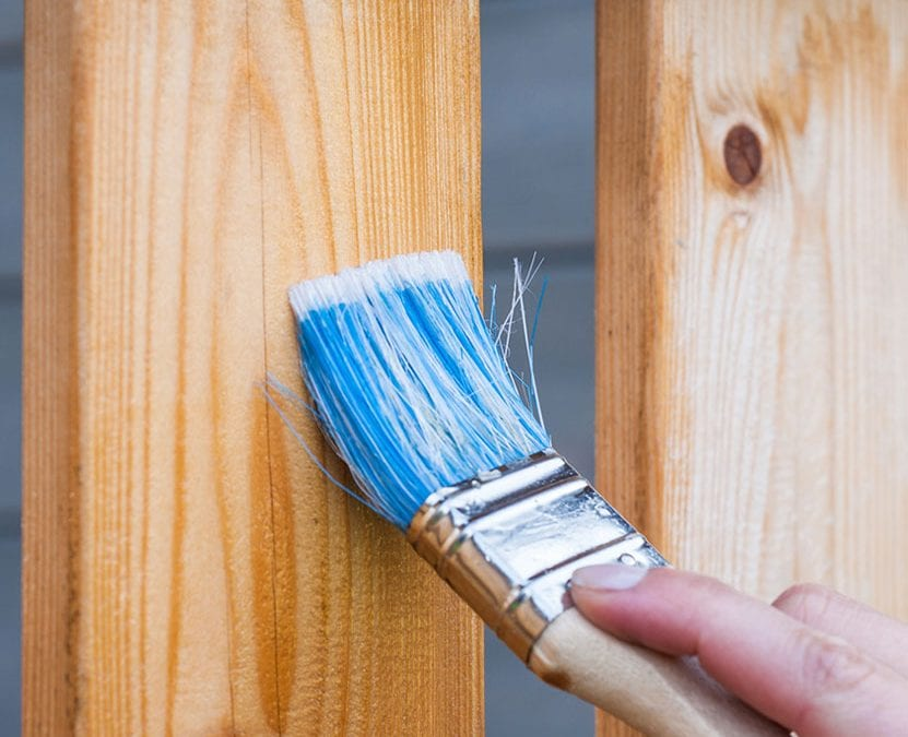 Varnishing wood fencing