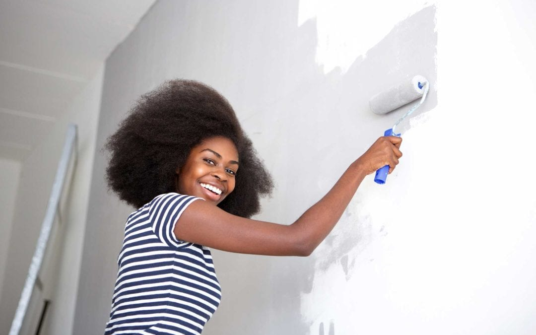 young woman painting walls